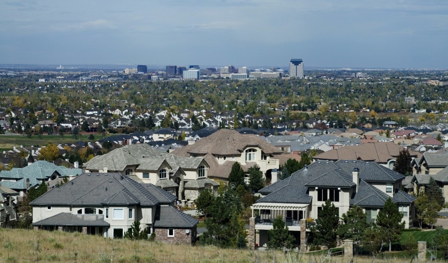 Picture is of a wealthy Denver suburb with the Denver Tech Center in the background.