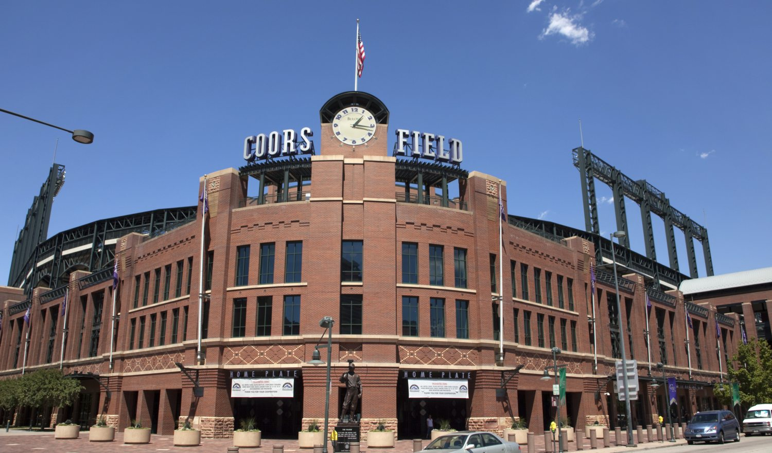 """Denver, Colorado, U.S.A. - August 15, 2011: The brick architecture of Coors Field baseball stadium stands under a blue sky in downtown Denver, Colorado."""