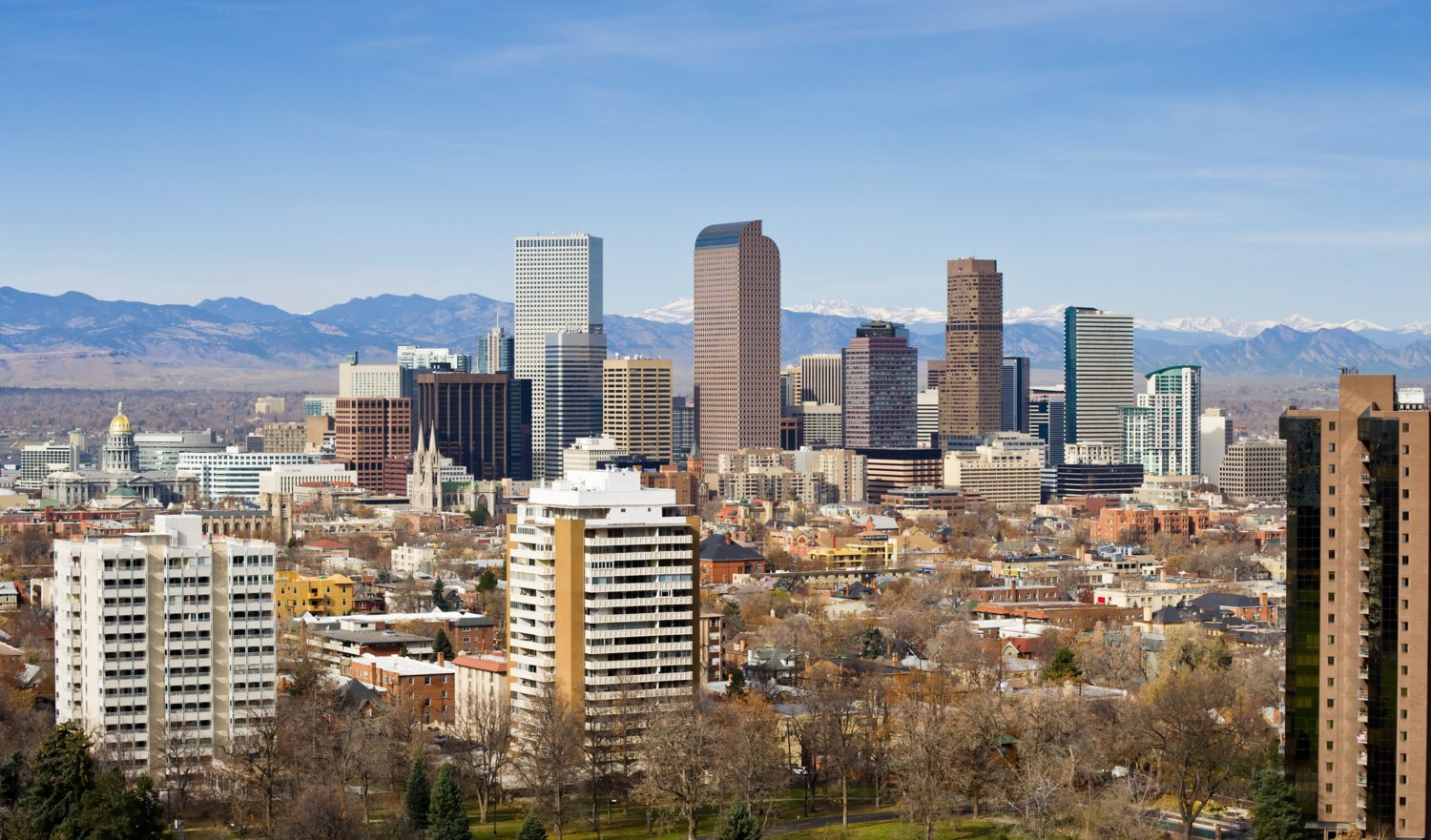 View of Denver Colorado Skyline.  Looking at city with mountains in background.  Converted from 14-bit Raw file.  sRGB color space.