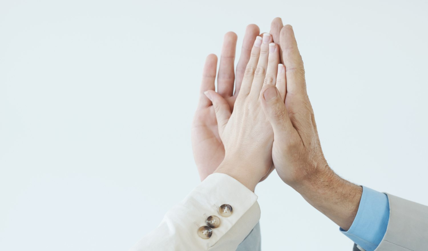 Business people celebrating another success deal with a high-five