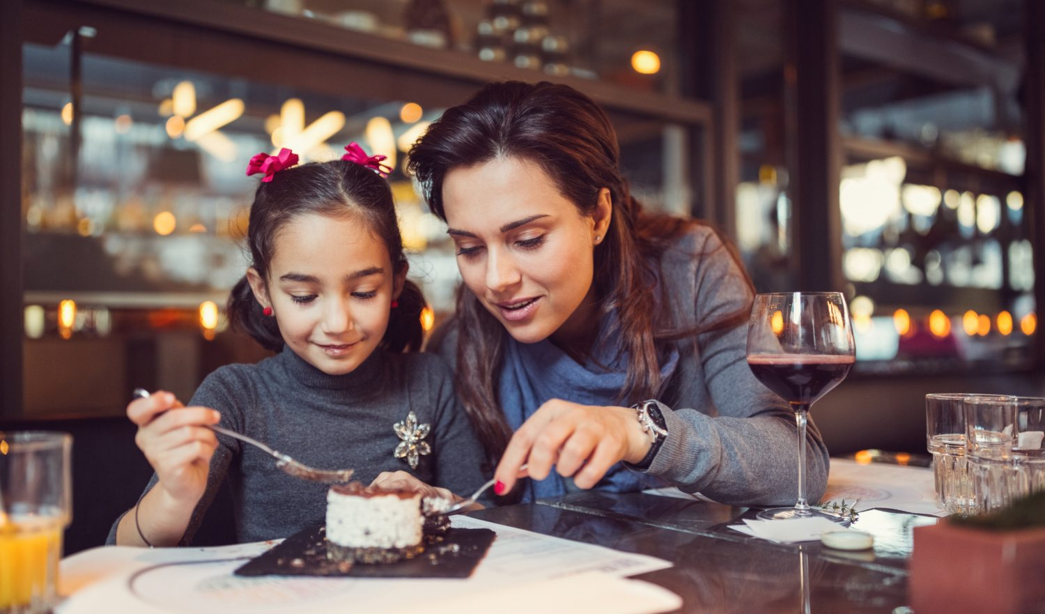 Mother and her daughter eating lunch in gourmet restaurant
