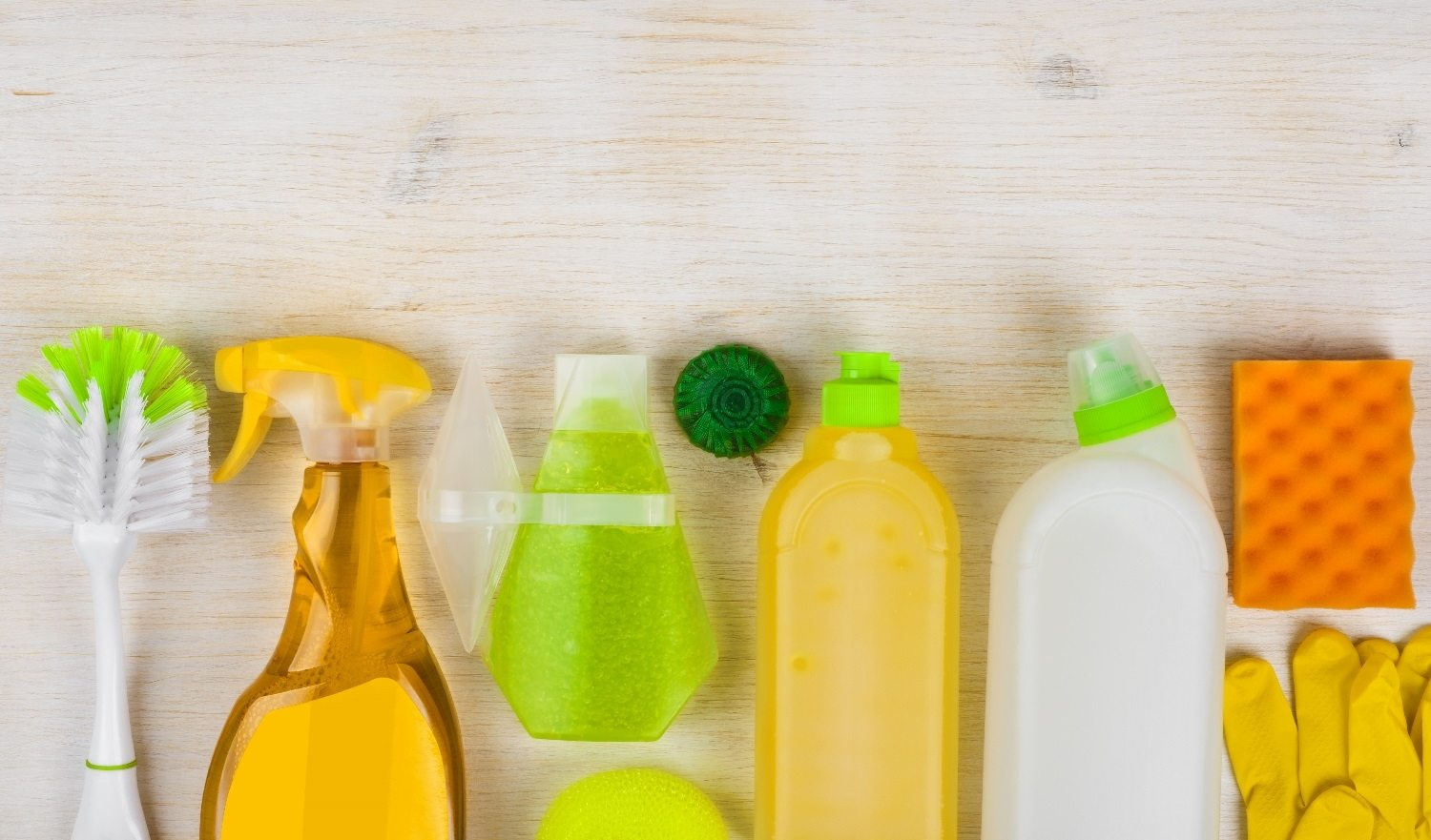 Cleaning products on wooden background with copy space at bottom